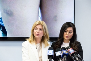 Andrea Buera (R), who is accusing Trey Songz of assaulting her, speaks during a press conference with her attorney Lisa Bloom
